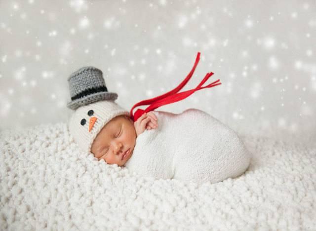 Μωράκια φωτογραφίζονται για τα πρώτα τους Χριστούγεννα
